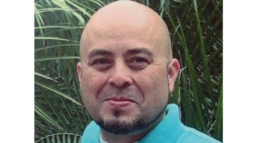 This June 2013 file photo released by the Hernandez family Nov. 2, 2013, shows Transportation Security Administration officer Gerardo Hernandez.