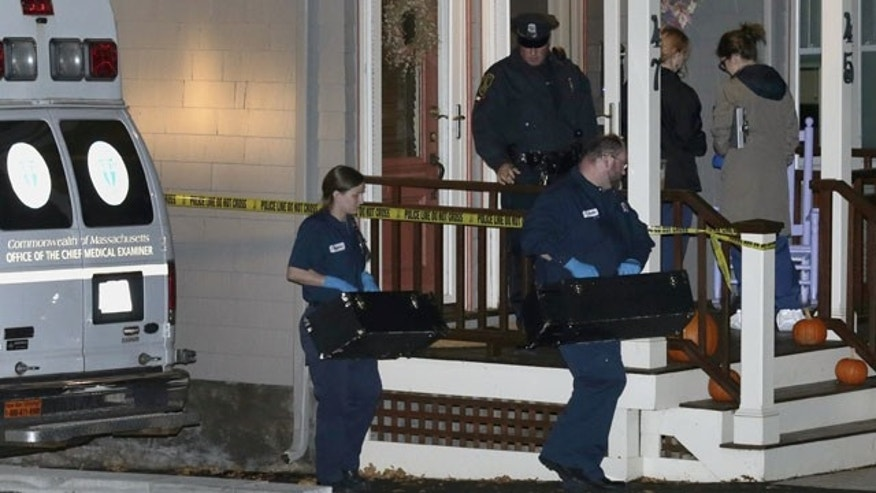 November 18, 2013: Workers from the Massachusetts medical examiner's office carry two small boxes to a home in a neighborhood of Arlington, Mass.