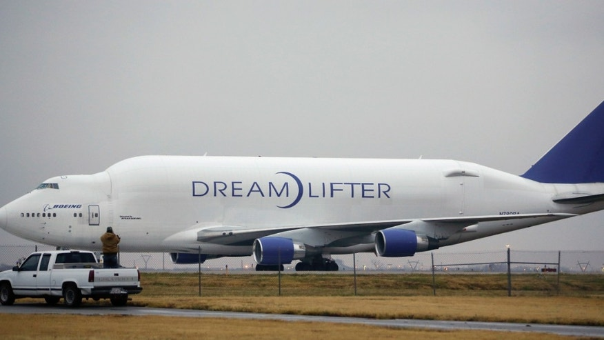 Nov. 21, 2013: A man takes a photo of the Boeing 747 LCF Dreamlifter from the back of his truck after the aircraft accidentally landed at Col. James Jabara Airport in Wichita, Kan. Wednesday night.
