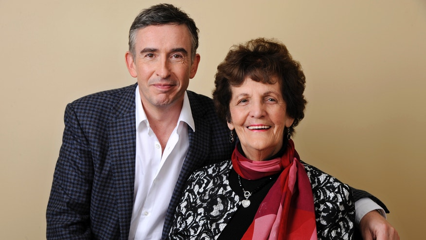 """In this Wednesday, Nov. 13, 2013 photo, Philomena Lee, right, poses for a portrait with Steve Coogan, a cast member in the film """"Philomena,"""" at the Four Seasons Hotel in Beverly Hills, Calif. Lee was an unwed, pregnant teenager in 1952 when her Irish Catholic family sent her to a convent in shame. After three years, the boy was sold for adoption to the United States, and Lee spent the next five decades looking for him. Coogan optioned Sixsmith's 2009 book, """"The Lost Child of Philomena Lee,"""" without even reading it, determined to bring the story to the screen.  (Photo by Chris Pizzello/Invision/AP)"""