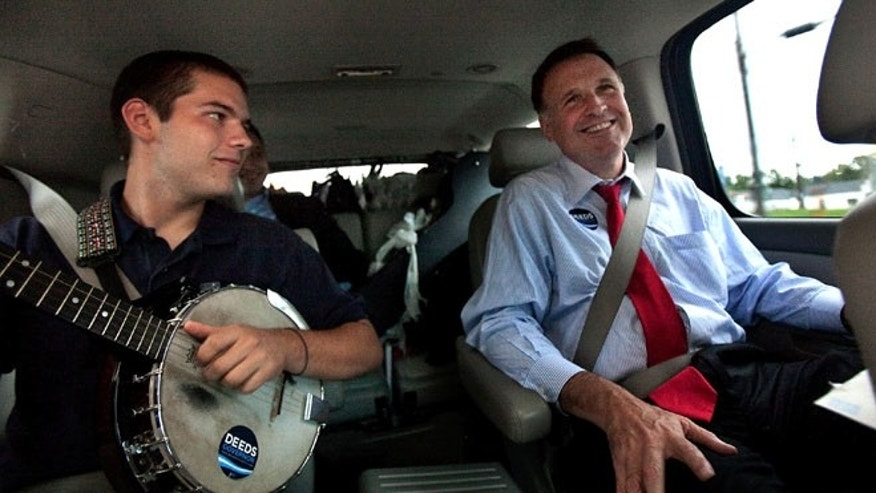 In a Sept. 25, 2009 photo, Democratic gubernatorial candidate Creigh Deeds spends time with his son Gus, left, on the road to Halifax, Va., between campaign events.