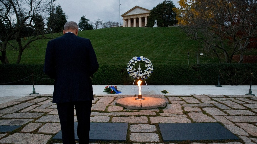 Attorney General Eric Holder pays his respects at the grave of John F. Kennedy at Arlington National Cemetery on Friday, Nov. 22, 2013, on the 50th anniversary of Kennedy's death. Holder has been visiting the grave since his youth. (AP Photo/Jacquelyn Martin)