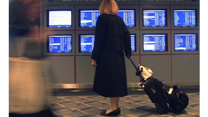 "386325 02: A United Airlines flight attendant stops to look at a departure flight information display March 5, 2001 at O''Hare International Airport in Chicago, IL. Hundreds of airline flights in and out of the Northeast United States were canceled as a ""Nor''easter"" winter storm threatened to blast the region with snow and ice. (Photo by Tim Boyle/Newsmakers)"