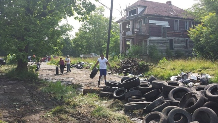 A vacant area in the east end of Detroit being cleared out of debris to make way for an upcoming tree farm.