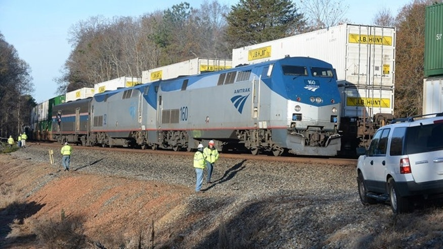 Nov. 25, 2013: Railway workers inspect an Amtrak train derailed in Spartanburg County, S.C.