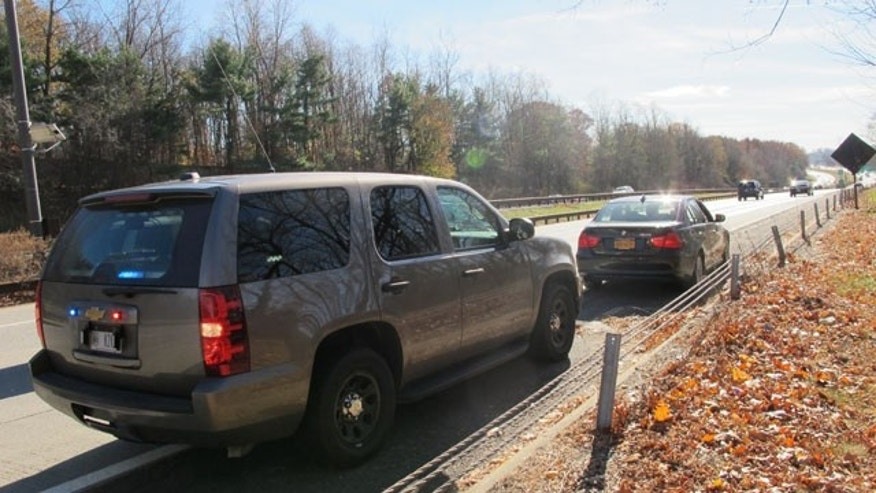 November 14, 2013: An unmarked New York State Police SUV is seen in Mount Pleasant, N.Y. after a trooper pulled over another driver for distracted driving. Troopers are using a fleet of the tall SUVs as part of a crackdown on texting while driving. (AP Photo/Jim Fitzgerald)