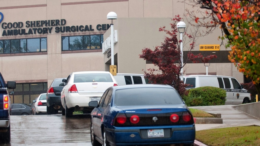 Longview Police Department detective units and two physical evidence section vans sit outside Good Shepherd Ambulatory Surgical Center after a stabbing Tuesday, Nov. 26, 2013, in Longview, Texas. A nurse died and four people were injured. (AP Photo/The News-Journal, Kevin Green)