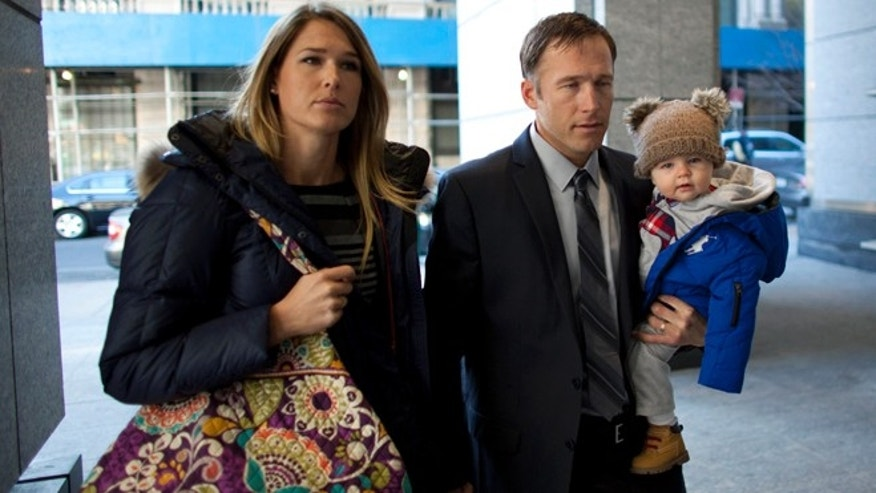 Nov. 25: Olympic alpine skier Bode Miller arrives with his wife Morgan and his son at Manhattan's Family Court.