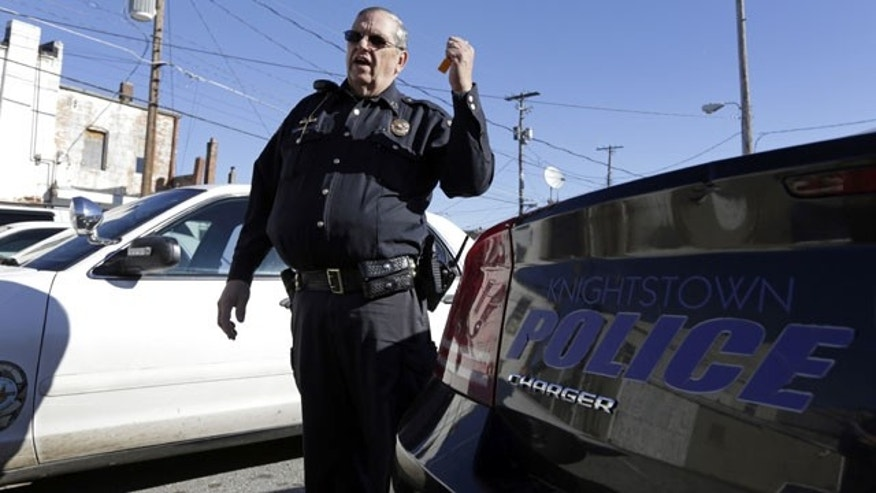 November 14, 2013: Knightstown (Ind.) Police Chief Danny Baker talks about the condition of the department's patrol cars. Baker is trying to raise money to lease a new car for the department by agreeing to be shot with his Taser. (AP Photo/Michael Conroy)