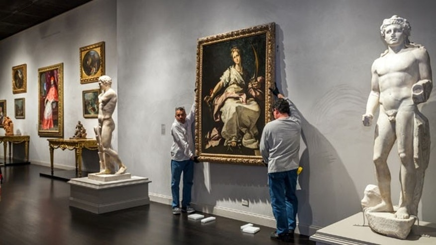 November 25, 2013: This photo released by Los Angeles County Museum of Art shows an installation of a painting, St. Catherine of Alexandria, painted by Bernardo Strozzi at the Los Angeles County Museum of Art. The Baroque-era painting created in 1615 was looted by the Nazis in 1944 was installed at the Los Angeles County Museum of Art after it was returned to its owner and donated to LACMA. (Los Angeles County Museum of Art)