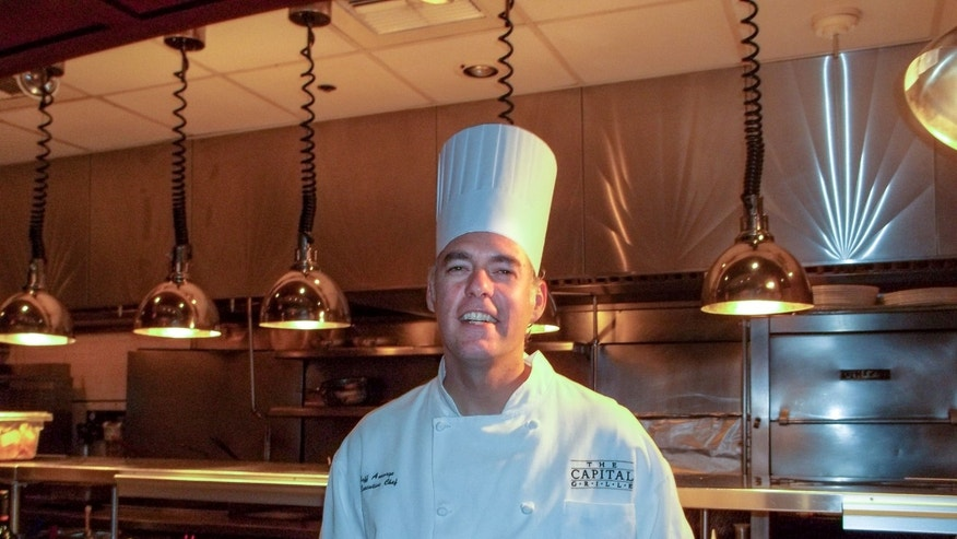 In this undated photo provided by The Capital Grille, chef Jeff Ansorge poses for a photo at the grill in Minneapolis. Ansorge, who used to command a staff of 17 at the posh downtown Minneapolis restaurant making nearly $80,000 a year, gave it all up to become the cook in charge of a Salvation Army soup kitchen where the meals are free and he makes a third of his previous salary. (AP Photo/The Capital Grille)