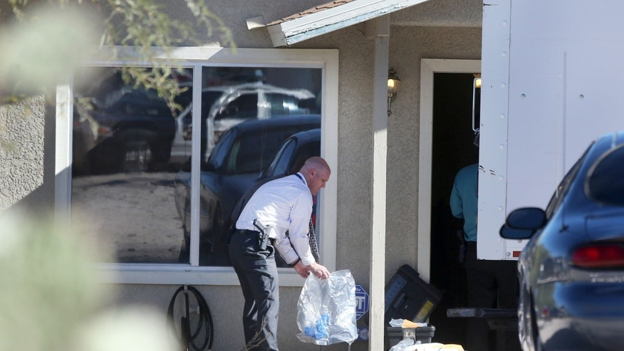 Tucson Police Department investigators and evidence technicians investigate the scene at a home where two people were arrested Tuesday, Nov. 26, 2013, after three girls told authorities that they have been imprisoned for possibly the past two years, in Tucson, Ariz. Tucson police said the girls are siblings — ages 12, 13 and 17 — and their mother and stepfather have been arrested in a case that's being investigated as alleged child abuse and imprisonment. (AP Photo/Arizona Daily Star, Mike Christy) ALL LOCAL TV OUT; PAC-12 OUT; MANDATORY CREDIT