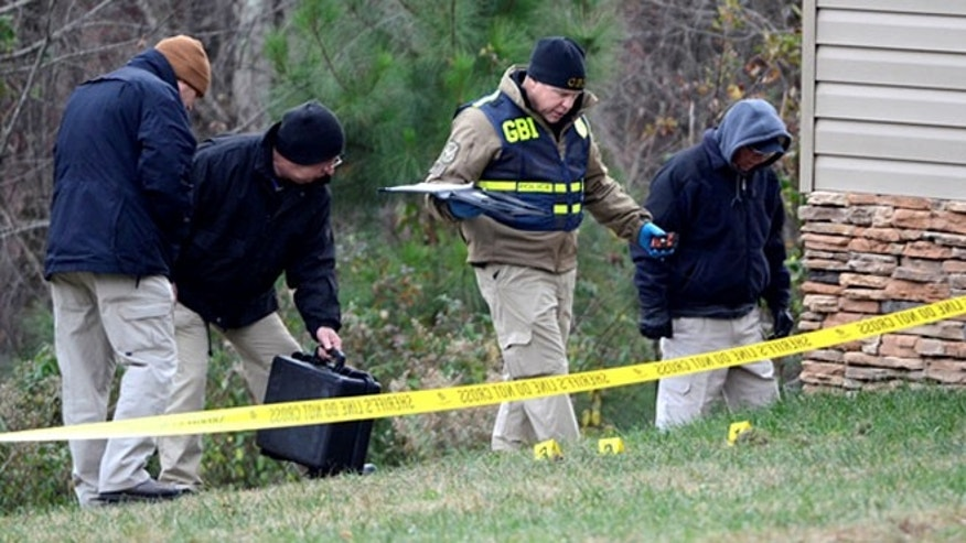 Investigators search for evidence after a police say a Georgia fatally shot an elderly man suffering from Alzheimer's. Police have not brought charges in the man's death.
