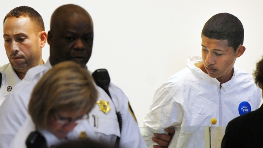 Oct. 23, 2013: Philip Chism, 14, stands during his arraignment for the death of Danvers High School teacher Colleen Ritzer in Salem District Court in Salem, Mass. Chism has been ordered held without bail.