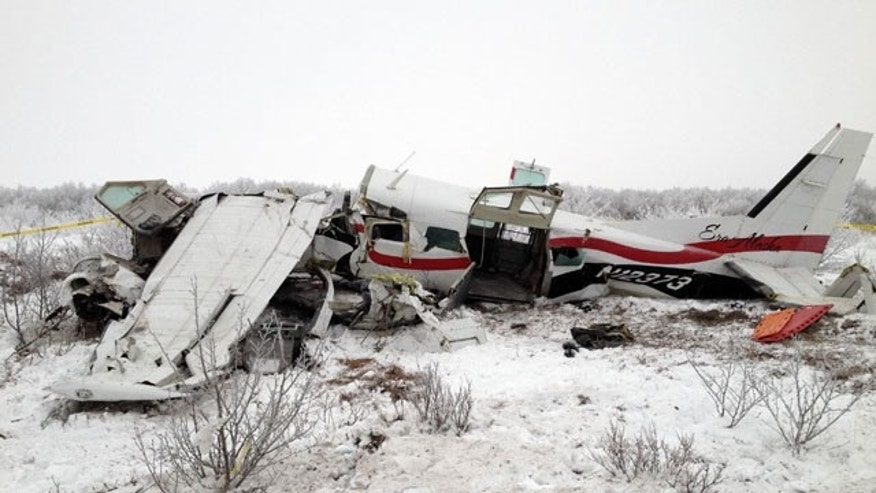 November 30, 2013: This image courtesy of Alaska State Troopers shows the wreckage of a plane that crashed Friday near St. Marys, Alaska. Authorities said the pilot and three passengers died in this crash of the single-engine turboprop Cessna 208. Few other details, including the possible cause of the crash, are known. (AP Photo/Alaska State Troopers)