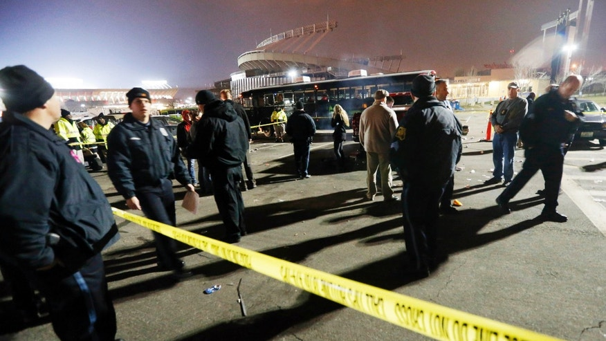 Kansas City, Mo. police work a crime scene in parking lot A outside Arrowhead Stadium, in Kansas City, Mo., after a person was killed Sunday, Dec. 1, 2013. Police Chief Darryl Forte said the death is being investigated as a homicide and that two suspects are in custody. (AP Photo/Orlin Wagner)