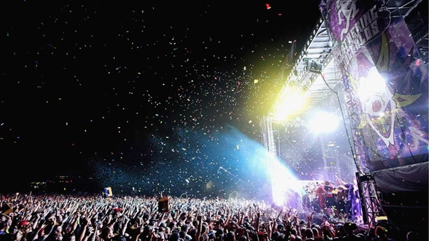 Aug. 11, 2012: Confetti is released over the crowd for the grand finale of Insane Clown Posse's headline performance on the final night of the Gathering of the Juggalos at Cave-In-Rock, Ill.