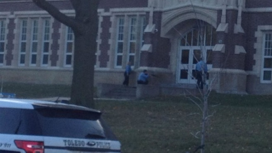 Dec. 2, 2013: Authorities are seen responding to a standoff at Scott High School in Toledo, Ohio.