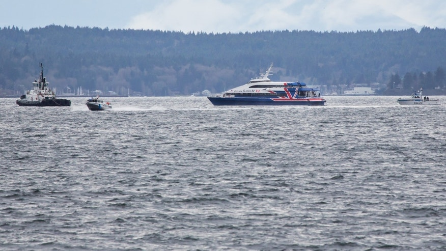 A police vessel moves hastily towards the waterfront, away from the Victoria Clipper which has been adrift in Elliot Bay since this morning, in Seattle, Sunday, Dec. 1, 2013. (AP Photo/The Seattle Times, Marcus Yam) OUTS: SEATTLE OUT, USA TODAY OUT, MAGAZINES OUT, TELEVISION OUT, SALES OUT. MANDATORY CREDIT TO:  MARCUS YAM / THE SEATTLE TIMES