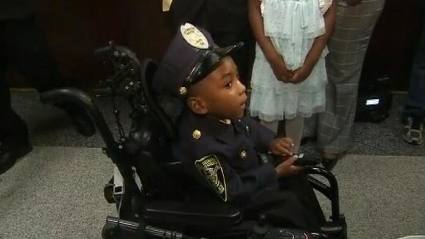 Dec. 2, 2013: Morgan Steward, 5, is sworn in as a honorary police officer in Covington, Ga.