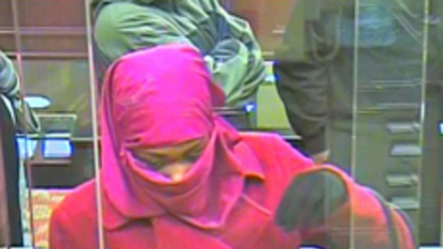 In this Monday, Dec. 2, 2013 surveillance photo, a woman appears inside a bank in Landover, Md. Prince George's County Police are looking for the woman who they say robbed the Capital One Bank on Annapolis Road in Landover. (AP Photo/Prince George's County Police Department)