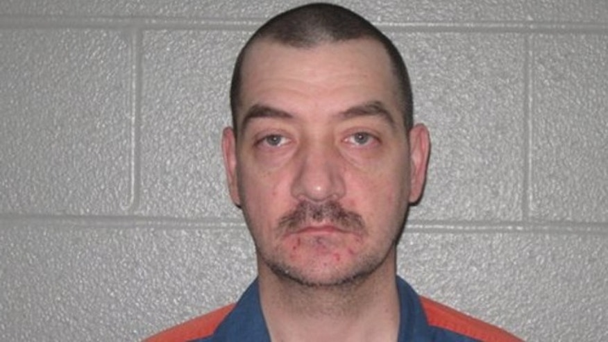 Nov. 22, 2013: This photo released by the Michigan Department of Corrections shows Jamie L. Peterson, 39, who is serving life without parole for first-degree murder and rape in the 1996 killing of Geraldine Montgomery at her home in Kalkaska, Mich.