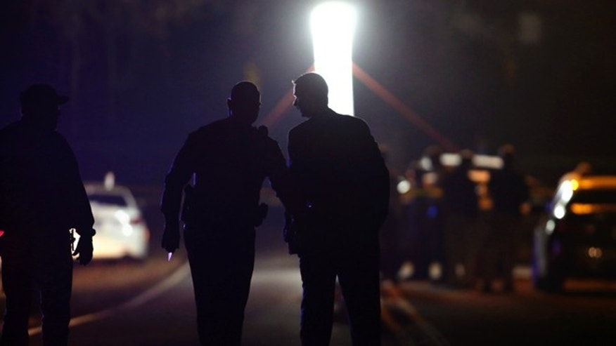 Dec. 4, 2013: Police investigate a shooting near Wingate University on in Wingate, N.C.
