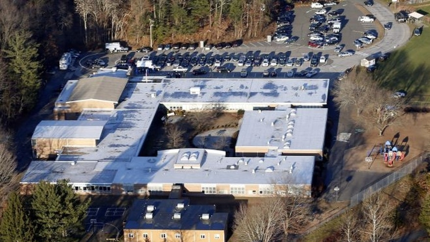 FILE: Dec. 14, 2012: This aerial photo shows Sandy Hook Elementary School in Newtown, Conn. Newtown, Conn.