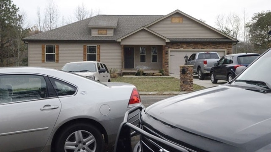 November 27, 2013: Cars are parked at a Cottage Crest Court home after a 72-year-old Alzheimer's patient was shot on the property, near Chickamauga, Ga.