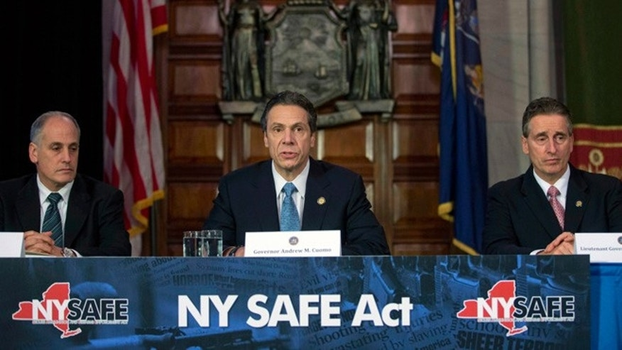 Jan. 14: Gov. Andrew Cuomo, center, speaks during a news conference announcing an agreement with legislative leaders on New York's Secure Ammunition and Firearms Enforcement Act at the Capitol.
