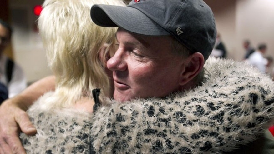 December 4, 2013: Dan Parker, right, the father of Wade Parker, who died fighting the Yarnell Hill Fire, receives a hug following an Industrial Commission of Arizona hearing in Phoenix. The commission approved a nearly $560,000 fine on Wednesday against the state Forestry Division after the Arizona Division of Occupational Safety and Health agency found that officials put protection of property ahead of safety and should have pulled out crews earlier. (AP Photo/The Arizona Republic, David Wallace)