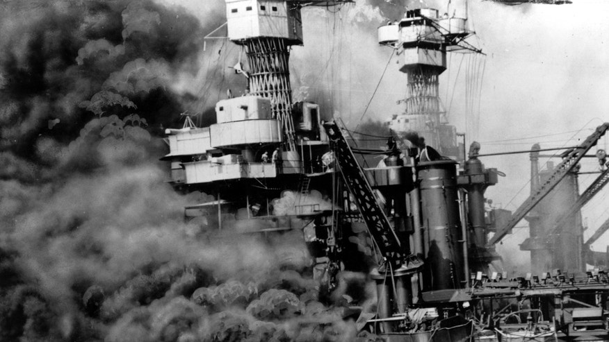 FILE - In this Dec. 7, 1941 file photo, a small boat rescues a crew member from the water as heavy smoke rolls out of the stricken USS West Virginia after the Japanese bombing of Pearl Harbor, Hawaii.  Two men can be seen on the superstructure, upper center.  The mast of the USS Tennessee is beyond the burning West Virginia. Saturday marks the 72nd anniversary of the attack that brought the United States into World War II. (AP File Photo)