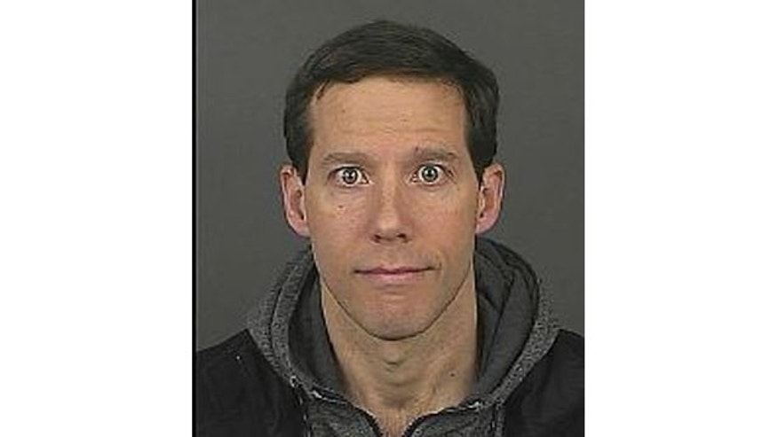 Aron Ralston's booking photo after his arrest early Sunday on misdemeanor domestic violence charges (Courtesy Denver Police)