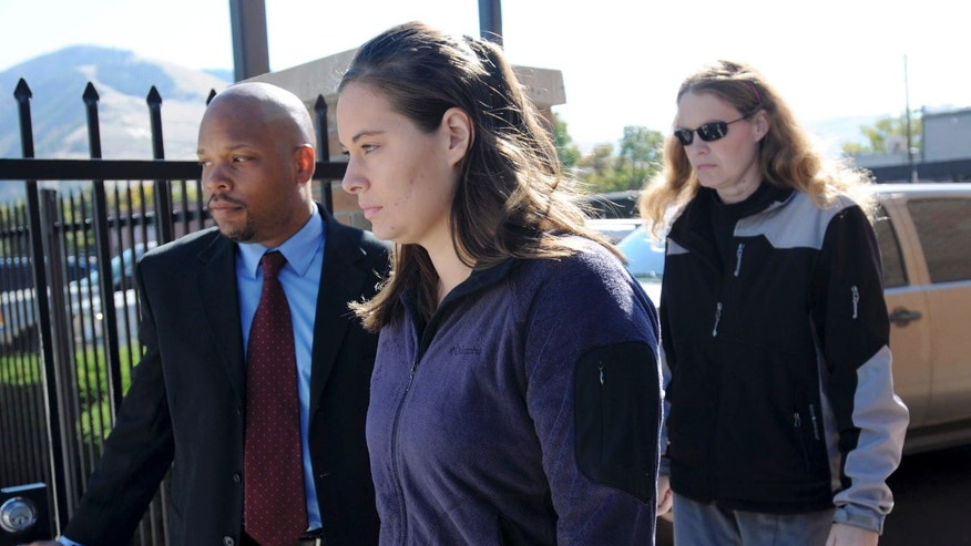FILE - In this Oct. 4, 2013 file photo, Jordan Linn Graham, center, leaves federal court, in Missoula, Mont.  Jury selection is scheduled to begin Monday Dec. 9, 2013, in Graham's trial on a charge of murder in the death of Cody Johnson, just eight days after the two got married. (AP Photo/The Missoulian, Michael Gallacher, File) TV OUT; MAGS OUT