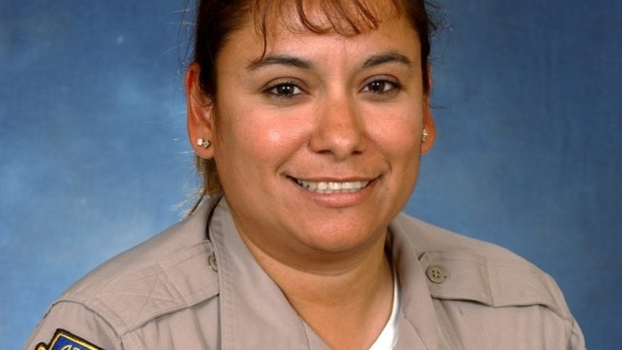 This undated photo provided by the Arizona Department of Public Safety shows Arizona's state police agency detective Carmen Figueroa.