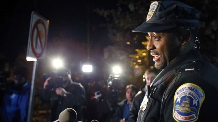 December 11, 2013: Washington Metro Police Lt. Jesse Porter speaks to the media outside American University in Washington. At the news conference after the lockdown had been lifted, Porter said the lockdown order was given after a student reported seeing a man with a holster on the shuttle. Porter said police have not confirmed that there was a weapon inside the holster. Police identified the man and determined that he was an off-duty police officer. (AP Photo/Alex Brandon)
