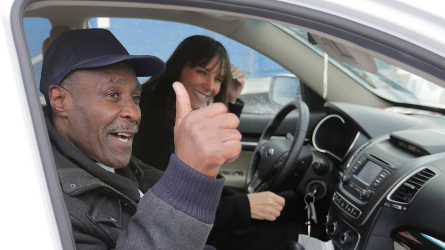 Stanley Wrice, left, convicted of rape and sentenced to 100 years in prison in 1982 gives a thumbs-up sign as he and his attorney Jennifer Bonjean, leave Pontiac Correctional Center Wednesday, Dec. 11, 2013 in Pontiac, Ill. Wrice was released after serving more than 30 years in prison when a Cook County Judge overturned his conviction the day before and granted him a new trial. Wrice has claimed for decades he was beaten and coerced into confessing to the rape by Chicago police Area 2 detectives working for disgraced former Chicago police Lt. Jon Burge. Burge himself, is now in federal prison after being convicted of perjury related to torture allegations.Judge Richard Walsh's ruling comes after the officers working for Lt. Burge  who Wrice says beat him, invoked their right not to testify. (AP Photos/M. Spencer Green)