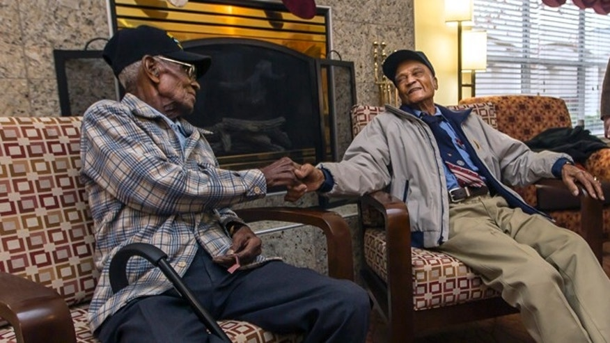 Dec. 13, 2013: Richard Overton, 107, left, and Elmer Hill, 107, center, shake hands before Austin Texas Mayor Lee Leffingwell, right, presents a proclamation acknowledging and thanking Overton, and Hill for their service.