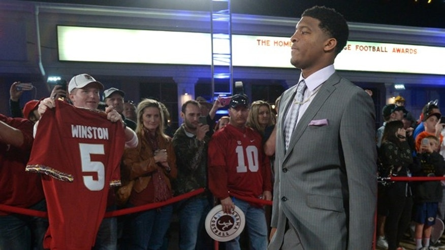 Dec. 13: Florida State quarterback Jameis Winston walks down the red carpet after arriving for the College Football Awards show in Lake Buena Vista, Fla.