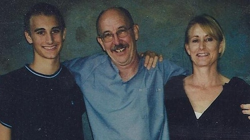 John Knock, center, smiles during a visit with his son Aaron and ex-wife Naomi in an undated photo. Knock said he's aware of the seismic shift regarding the public opinion of marijuana and hopes he'll one day be freed despite his sentence of life without parole plus 20 years. (Courtesy: Beth Curtis)