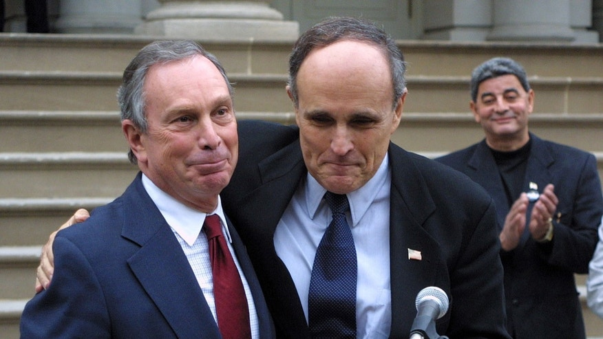In this Oct. 27, 2001, file photo Mayor Rudolph Giuliani, center, endorses Republican mayoral candidate Michael Bloomberg, left, on the steps of City Hall in New York. Giuliani's popularity soared after the Sept. 11  terror attack and his endorsement of Bloomberg, combined with panic among voters about the city's safety and fiscal future, propelled the businessman to a narrow win. Bloomberg went on to serve for mayor for 12 years, and now, as he prepares to leave office at month's end, he has dramatically reshaped the city. (AP Photo/Robert Spencer, File)