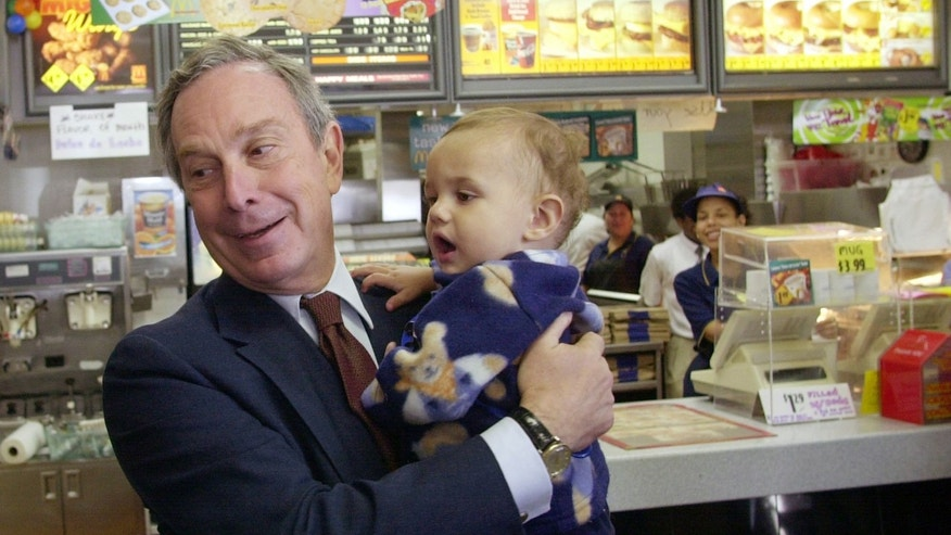 In this Nov. 5, 2001 file photo, Michael Bloomberg holds 11-month-old Joshua Rodriguez while campagning for mayor during an impromptu campaign stop at a Brooklyn McDonald's restaurant in New York.  Bloomberg went on to win the election and during his 12-years in office zeroed in on fast food chain restaurants witH innovative public health policies that appear to have added years to residents' lives. (AP Photo/Suzanne Plunkett, File)