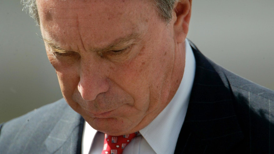 In this Sept. 11, 2002 pool photo, New York City Mayor Michael Bloomberg bows his head as he leaves the podium after speaking at a ceremony marking the one year anniversary of the Sept. 11 attacks on the World Trade Center in New York. When Bloomberg became New York City's mayor 12 years ago, he was a political neophyte faced with the aftermath of the Sept. 11 terror attacks. Now, as he prepares to leave office at month's end, he has dramatically reshaped the city. (AP Photo/The New York TImes, Ruth Fremson, Pool, File)