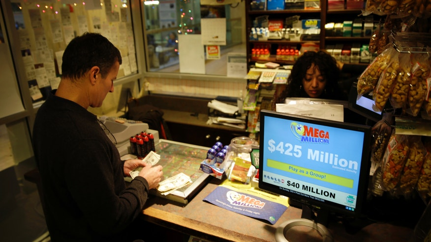 Chad Cuneo counts out his money for his to buy Mega Millions lottery tickets at a newsstand Friday, Dec. 13, 2013, in Philadelphia.  Superstition didn't deter players hoping that Friday the 13th will bring them good luck in the Mega Millions game as heavy sales prompted lottery officials to boost the estimated jackpot to $425 million.  (AP Photo/Matt Rourke)