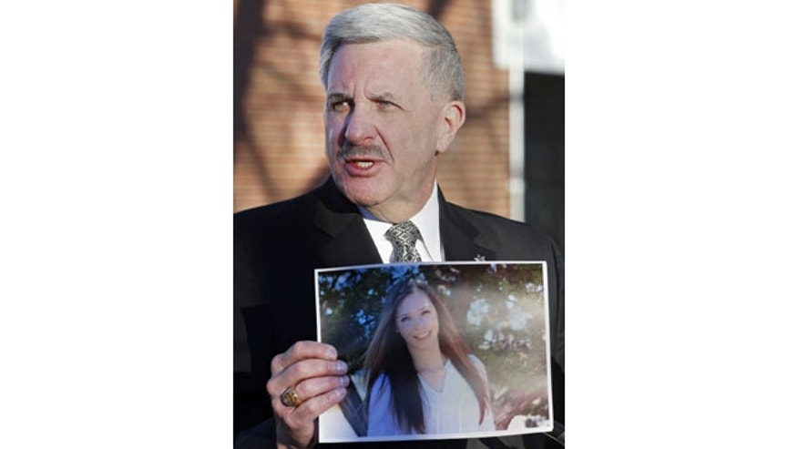 December 14, 2013: Arapahoe County Sheriff Grayson Robinson holds a picture of Claire Davis during a briefing, at Arapahoe High School in Centennial, Colo. Davis was shot by 18-year-old shooting suspect Karl Halverson Pierson at the school on Friday before he took his own life. (AP Photo/Ed Andrieski)