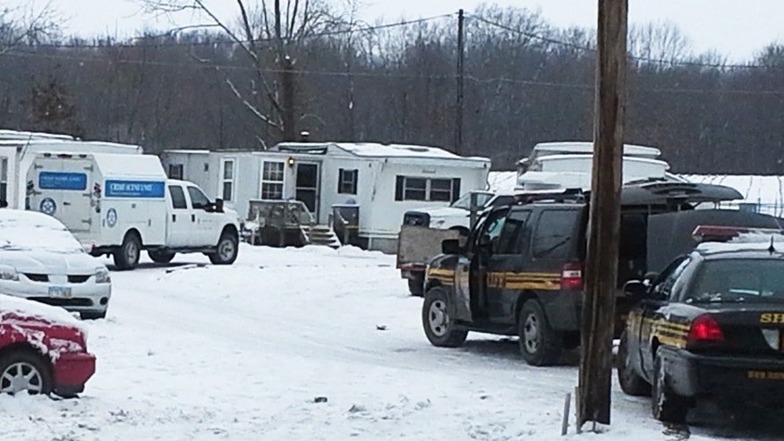Wayne County sheriff's deputies secure the scene while investigators from the Ohio Bureau of Investigation search a mobile home in Wayne County's Green Township on Sunday, Dec. 15, 2013.  Jerrod Metsker, 24, was arrested at his home on a murder charge about 12 hours after deputies found the body of Reann Murphy near her home at a mobile park in Smithville, about 30 miles southwest of Akron, Sheriff Travis Hutchinson said. Reann was last seen Saturday night playing outdoors at the park. Officers, firefighters and neighbors joined in the search for Reann, going door-to-door and combing area properties. Hutchinson wouldn't say how Reann was killed or offer a motive. He described Metsker as a family friend and neighbor.  (AP Photo/Akron Beacon Journal,  Mary Beth Breckenridge)  MANDATORY CREDIT