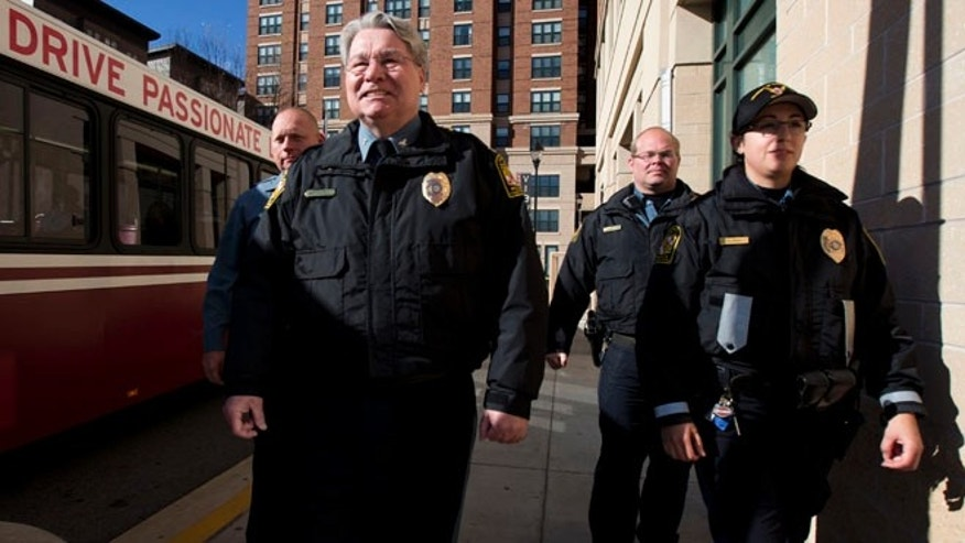 Nov. 25: University of Maryland Police Department Police officers walk on a sidewalk at the extended jurisdiction area of the University of Maryland in College Park, Md.