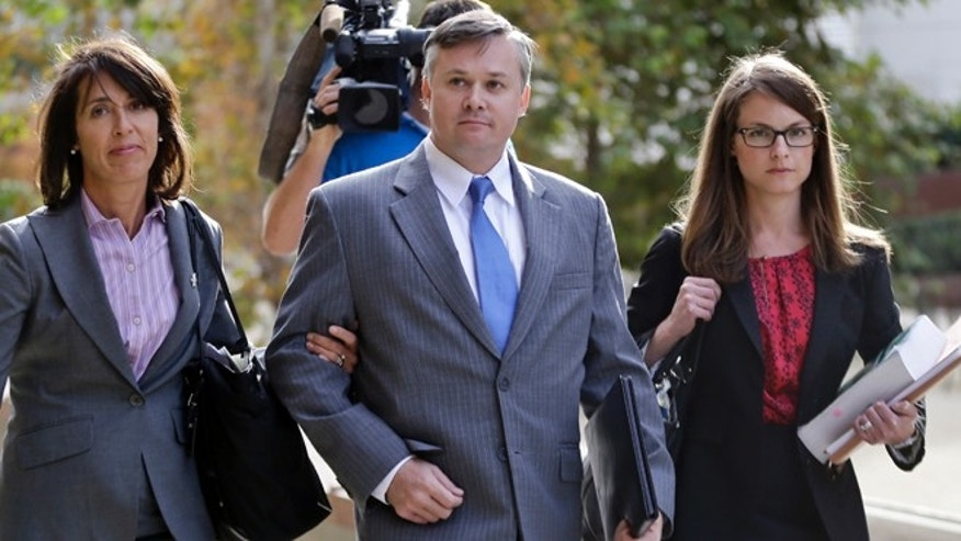 Dec. 17, 2013: John Beliveau II, center, and his attorneys, Gretchen von Helms, left, and Jessica Carmichael arrive at a federal courthouse in San Diego.