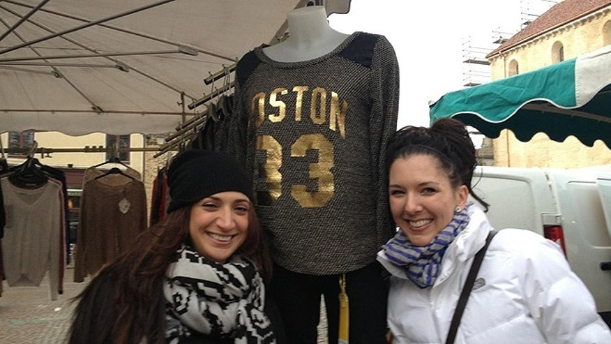 Boston Marathon bombing survivors Sabrina Dello Russo, left, and Michelle L'Heureux inexplicably managed to find a Larry Bird jersey during a stop in Cluny, France. (Courtesy: Casey Sherman)