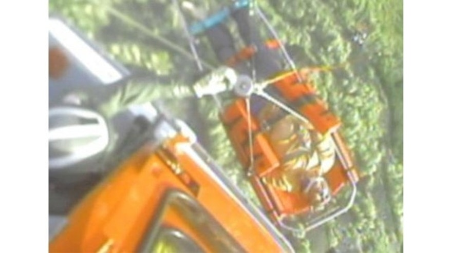 Dec. 17, 2013: Coast Guard Air Station Borinquen MH-65 Dolphin helicopter crew members hoist a 60-year-old man, who reportedly sustained multiple injuries after falling over 100-feet from a mountain in Yauco, Puerto Rico.